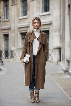 Stockholm Street Style glamhere.com Beige suede duster coat white turtleneck sweater jeans and snake booties.