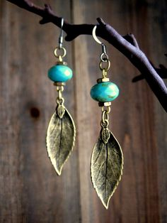 Rustic Turquoise Leaf Dangle Earrings Handmade Leather Jewelry Earthy Steampunk. $30.00, via Etsy.