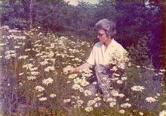 Margaret Renn, 1975, picking wild daisies above Little Muncy Creek