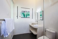 We have two Deluxe Rooms, each with a King bed and a private bathroom.