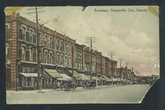 This postcard shows the corner of Broadway and First St., with the original 199 Broadway building on the left.