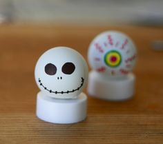 Glowing Halloween Craft...cheap and easy!  Ping Pong balls, flameless candles and a little imagination.
