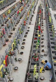 In Xiangfan, China, a man burned offerings at family grave April 3, two days before the busy Qing Ming festival.