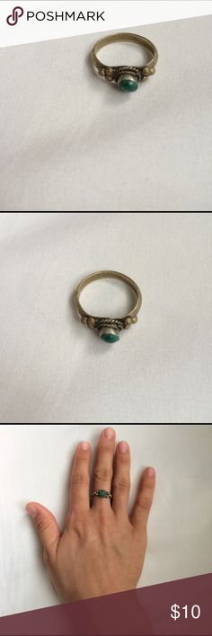 Antique Stone Ring Selling an antique-style green stone ring set in a tarnished colored gold setting.  Fits size 6-6.5 nicely.  Cute with boho style outfits, beach outfits or casual wear. Jewelry Rings