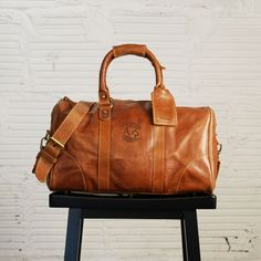 Front view of the Alpha Phi custom leather overnight duffel bag.