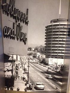 "Vintage photo of ""Hollywood and Vine"" sign overlooking Capitol Records building in Los Angeles. Note the lack of traffic."