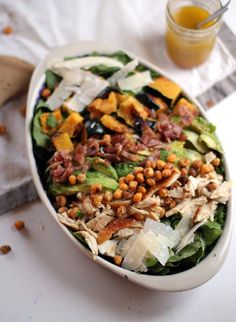 Amazing Fall Salad!         spinach     romaine lettuce     shaved parmesan cheese     roasted chickpeas     avocado     roasted chicken, shredded     bacon, cooked and crumbled     acorn squash, roasted and cut into chunks (we like the skin on, but you could definitely take it off)