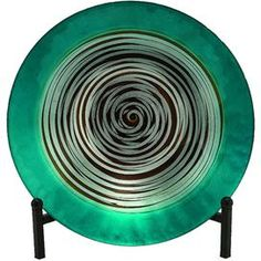 """Bring a luxe pop of color to your credenza, hutch, or sideboard with the Citron Bowel with Easel II, showcasing a lustrous spiral motif vibrant emerald finish.    Product: Bowl and easel   Construction Material: Glass   Color: Green  Dimensions: 16"""" Diameter  Note: Not recommended for outdoor use  Cleaning and Care: Wipe with dry cloth"""