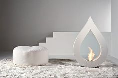Interior, Appealing Big Flame White Teardrop Fireplace Along With White Puff As Well As White Fur Rug: Amazing fireplace walls in your home Bioethanol Fireplace, Fireplace Wall, Fireplace Design, White Fireplace, Fireplace Ideas, Floral Frames, Modern Fountain, Light My Fire, Blog Deco