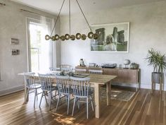 New house remodel in Maine by Jersey Ice Cream Co., glam eat-in kitchen included Vintage Farmhouse, Farmhouse Homes, Vintage Kitchen, Eat In Kitchen, Kitchen Dining, Kitchen White, Kitchen Chairs, Mid Century Sideboard, Dining Room Inspiration
