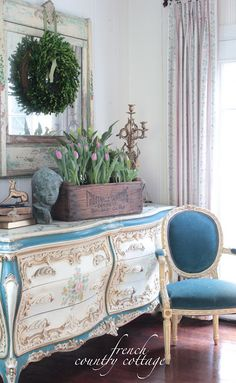 FRENCH COUNTRY COTTAGE: Rustic Fruit Crate.  I love the blue sideboard or dresser and blue chair.