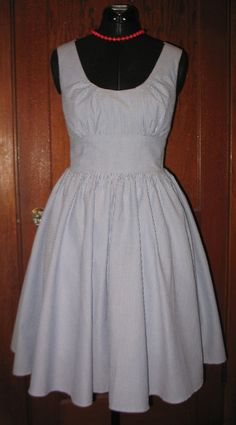 I wonder if I could find a dress pattern like this one for mom to make me....