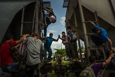 "Undocumented migrants pass a boy between two cars on a moving northbound freight train known as ""The Beast,"" because of rampant accidents and violent crime, as it passes through Tenosique, Mexico, July (Photo: Meridith Kohut / The New York Times) Boxer Mix Puppies, Pitbull Boxer, Play Doh Fun, Violent Crime, Building For Kids, Political Events, Borderlands, Photo Credit, El Salvador"