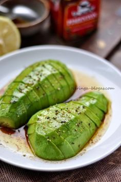 Marinated Avocado: Black Pepper, Olive Oil, Soy Sauce, & Lemon Juice. Leave in the fridge over night, eat the next day.