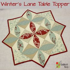 "Day 22 of Quilter's Way's ""31 Days of Holiday Gifts"" features The Crafty Quilter's Winter's Lane Table Topper."