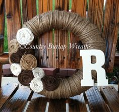 yarn monogram wreath add orange and burgundy and it would look so pretty wedding?