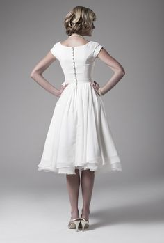 love this sweet retro wedding dress with cap sleeves and buttons up the back