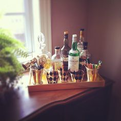 Bar tray  Make a boring desk or console table into a classy bar. Here is one way.