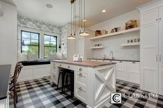 Black plaid flooring with accent wall paper and whimsical pendants