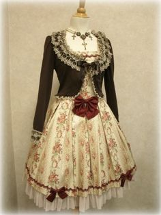 Classic Lolita - Floral patterned dress with mini jacket.