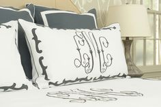 <3 monogrammed linens on a bed.. (by Leontine Linens)