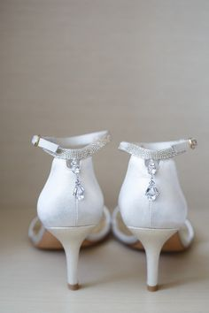 White wedding shoes with a touch of bling: http://www.stylemepretty.com/illinois-weddings/chicago/2015/12/07/classic-chicago-wedding/ | Photography: Ann Kam - http://www.annkam.com/