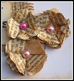 Easy flowers from book pages.. These would have to be from a newspaper... I couldn't reck a book, but still a cute idea