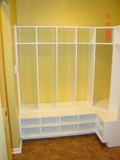 Homemade lockers with lots of shoe storage  This would be nice for between the front door and the fireplace.