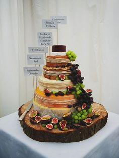 wedding cakes alternatives I like this non-traditional wedding cake.elegant stack of cheeses (plus a handmade pork pie). Obviously minus the pork pie for me. Traditional Wedding Cake, Traditional Cakes, Cheese Tower, Buffet Dessert, Dessert Food, Dessert Ideas, Wheel Cake, Cake Tower, Lodge Wedding