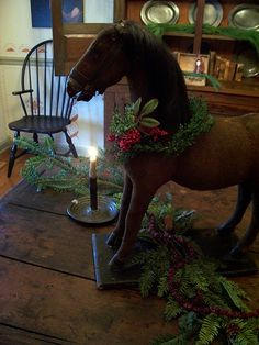 Antique Christmas-am thinking of doing this with the wooden rocking horse my grandkids have out grown Old Time Christmas, Prim Christmas, Old Fashioned Christmas, Antique Christmas, Simple Christmas, Winter Christmas, Xmas, Primitive Christmas Decorating, Primitive Country Christmas