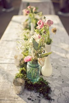 sheet music as place mat/ runner blue mason soft flowers vase - peet moss?  very vintage center pieces