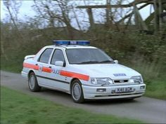 Sierra Saphire RS Cosworth Police Car - I remember these! British Police Cars, Old Police Cars, Police Gear, Ford Rs, Car Ford, Ford Sierra Cosworth, Radios, Emergency Vehicles, Police Vehicles