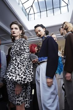 With dark lips and retro waves, the models backstage at the Marni Fall 2016 fashion show looked like they had arrived from another era.