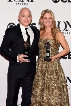 Michael Cervis (L), winner of the award for Best Performance by an Actor in a Leading Role in a Musical for 'Fun Home' and Kelli O'Hara, winner of the award for Best Performance by an Actress in a Leading Role in a Musical for 'The King and I' pose in the press room at the 2015 Tony Awards.