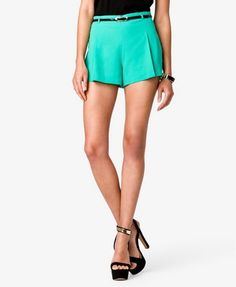 """A pair of pleated crepe by weave shorts featuring a high-waist. Faux patent leather belt with a buckle closure. Invisible zipper and hook-eye closure at the side. Unlined. Lightweight.     DETAILS:     •12"""" waist side seam to hem, 3"""" inseam, 28"""" leg opening, 11"""" rise, 28"""" waist  •Measured from Small  •100% polyester   •Hand wash cold, line dry  •Imported    Model Info: Height: 5'11"""" 