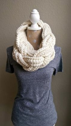 This is a free pattern offered on my blog for how to make this braided, infinity scarf! It uses half double crochet stitches. You will also learn how to braid a single strand (of crochet, knitting, yarn, anything!) in the photo tutorial on my blog. Enjoy!