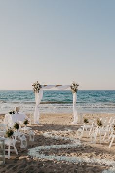 Romantic beach wedding set up beside the waves with a winding trail of rose petals leading to the beautiful wedding arch. Beach Wedding Locations, Beach Wedding Bouquets, Beach Theme Wedding Invitations, Beach Wedding Centerpieces, Beach Wedding Reception, Beach Wedding Photos, Wedding Set Up, Beach Ceremony, Beach Photos