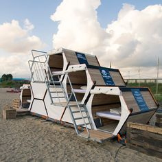 Modular honeycomb of wooden sleeping cells designed for festivals.