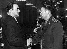Soviet cosmonaut Major Yuri Gagarin (right), shakes hand with Leonid Ilich Brezhnev, the General Secretary of the Central Committee of the Communist Party of the Soviet Union, after the Soviet statesman awarded Gagarin the Order of Lenin and a Gold Star medal of the Hero of the Soviet Union for his achievements in becoming the first man in history to travel in space. (AFP/Getty Images)