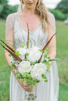 White flower and pheasant feather bouquet   Photography by http://folegaphotography.co.uk/