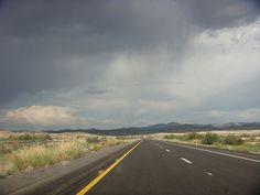 i love the smell of rain on a desert road. (Desert Rain by Todd Dwyer, via Flickr)