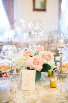 Light pink roses + white hydrangea centerpieces atop damask-patterned linens {Ashley Largesse Photography}