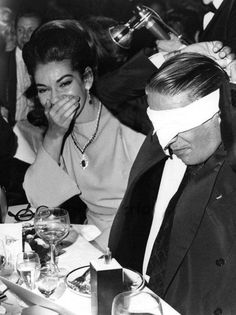Maria Callas and a blindfolded Aristotle Onassis