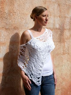 feel elegant and feminine with this pure White lacey poncho. This sexy beauty is the perfect accessory for many different occasions. Wear this