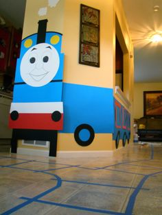 Thomas the Train DIY party decoration and display idea. This was a huge hit! Used poster board from #HobbyLobby and painters tape on the floor that went all the way around the house starting with the sidewalk outside!