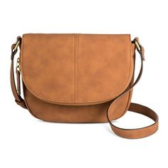 When you're getting ready to head out for a fun day, toss everything you need in the Tunnel Flap Crossbody Handbag and walk out the door. This adorable purse has a zipper pocket in the top flap and a roomy interior with plenty of pockets so you always know where everything is. With a thin construction that sits close to your body, you'll love taking this bag wherever you go.
