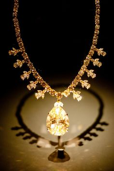 "The Victoria-Transvaal Diamond was cut from a 240-carat rough stone found at the Premier Mine in Transvaal, South Africa, in 1951. The pear shaped, fancy ""champagne-colored"" diamond was originally cut to 75 carats but then later recut to 67.89 carats for better proportions. Total weight of the 106 diamonds in the necklace is approximately 45 carats. The Victoria-Transvaal diamond was worn in the 1952 movie ""Tarzan's Savage Fury."""