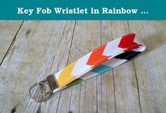 """Key Fob Wristlet in Rainbow Chevron Designer Fabric. This Key Fob Wristlet is a must have. They key fob wristlet allows you to have your hands free but still have your keys close at hand. Perfect for when you are carrying all those groceries in the house from the car (and lets face it, we all play that """"I'm only making one trip"""" game) and your keys are right there on your wrist. No need to have to dig in your bag for your keys, they are right there easily accessible. Not only that, if you…"""