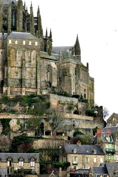 -Mont Saint-Michel, France-  I'd love to see this, but why does the bottom left look added in? lol