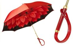 Luxurious double canopy Italian umbrella with a black exterior, complemented by a satin polyester interior that features a red dahlia on a gold canvas. It has a metal gilt frame and a unique red plexi Fancy Umbrella, Under My Umbrella, Beautiful Gold Rings, Beautiful Flowers, Umbrellas Parasols, Singing In The Rain, Black Canvas, Gold Canvas, Dark Lips